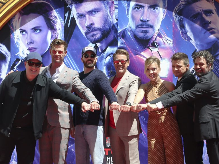 (From left) Marvel Studios President Kevin Feige, Chris Hemsworth, Chris Evans, Robert Downey Jr., Scarlett Johansson, Jeremy Renner and Mark Ruffalo, members of the cast of Avengers: Endgame in Los Angeles in April. The Marvel Cinematic Universe is getting a trans character, Feige says. (Willy Sanjuan/Willy Sanjuan/Invision/AP)