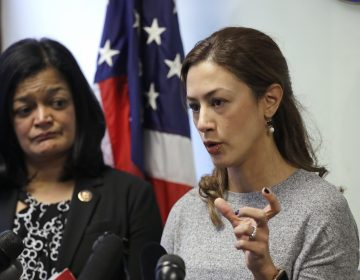 Rep. Pramila Jayapal, D-Wash., looks on as Negah Hekmati talks about her hours-long delay returning to the U.S. from Canada with her family days earlier, at a news conference on Monday. (Elaine Thompson/AP Photo)