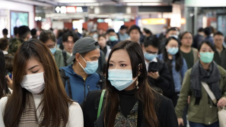 Passengers in a subway station in Hong Kong wear masks amid the coronavirus outbreak. (Kin Cheung/AP Photo)
