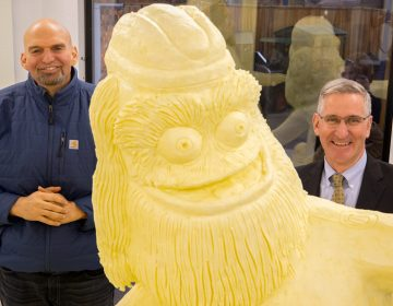 Lt. Gov. John Fetterman and Secretary of Agriculture Russell Redding pal it up with Butter Gritty