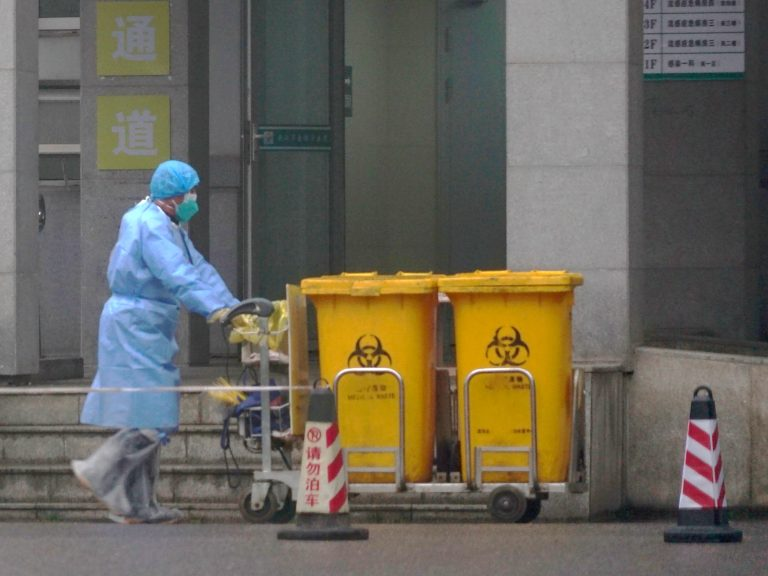 As more cases continue to be confirmed,health officials and medical works in Wuhan, China, and throughoutthe country ramp up efforts to contain the spread. (Dake Kang/AP Photo)