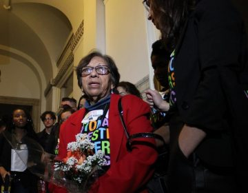 Mercedes, a domestic worker and member of the Pennsylvania Domestic Workers Alliance, speaks to reporters outside of the City Council chambers on Oct. 31 following the Law and Government Committee's passage of the Philadelphia Domestic Worker Bill of Rights. (Emily Neil/AL DÍA News)