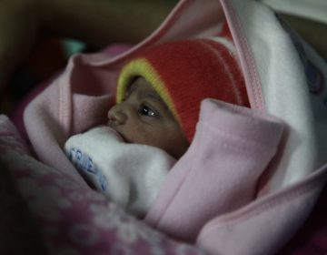 A 5-pound newborn girl is swaddled in a blanket in a hospital in Islamabad, Pakistan. She was born on Jan. 1, 2020. (Diaa Hadid)