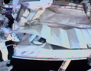This photo provided by NASA shows the view from NASA's Andrew Morgan's helmet cam as Italian astronaut Luca Parmitano works outside the International Space Station during a spacewalk Saturday. (AP Photo)