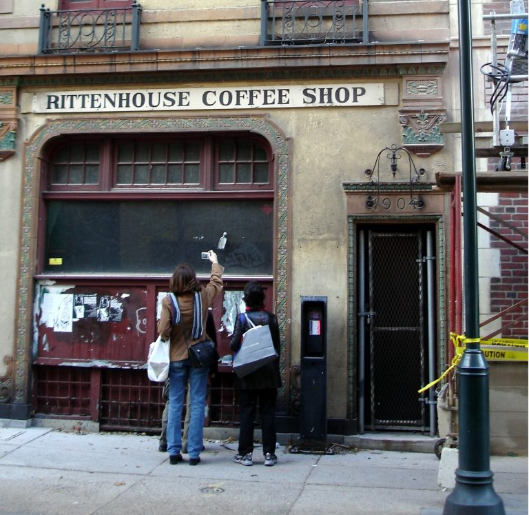 Two curious passersby study the former Rittenhouse Coffee Shop building at 1904 Sansom Street in 2005. (Elston via Flickr)