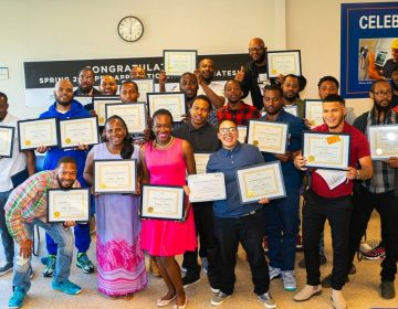 Graduates of a training course sponsored by the Post Bros. celebrate their graduation at the local community center. (Richard Allen New Generation)