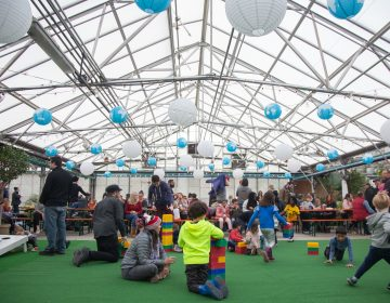Children romp and play on the 'lawn' at the Getaway at the Greenhouse. (Emily Cohen for WHYY)