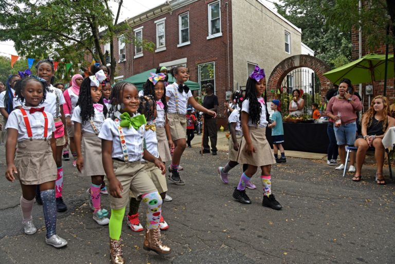 In September 2019, members of the Camden Sophisticated Sisters walk through Waterfront South to perform at the Hearts and Hands Festival sponsored by Sacred Heart Church.  (April Saul for WHYY)