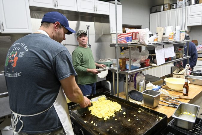 Volunteer firefighters prepare breakfast for the monthly 'All You Can Eat' event at the Social Quarters of Humane Fire Co., in Pottsville, Pa. (Bas Slabbers for Keystone Crossroads)