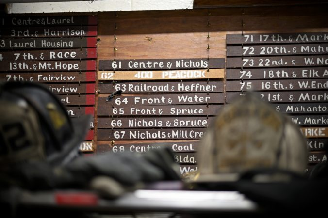 Firefighters' gear and call box locations at the fire house of the Humane Fire Co., in Pottsville, Pa. (Bas Slabbers for Keystone Crossroads)