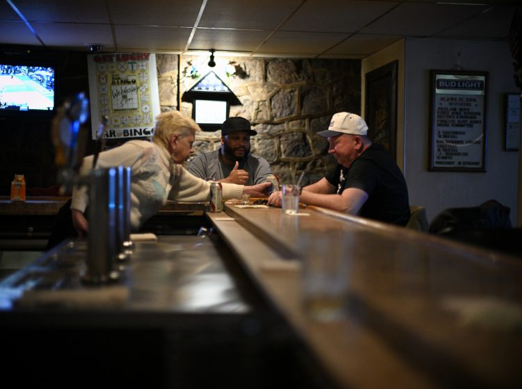 Andy Barrow and Ron Webb, sits at the bar of the Social Quarters at Deer Lake & West Brunswick Fire Company No. 1, in Orwigsburg, PA, on December 15, 2019.