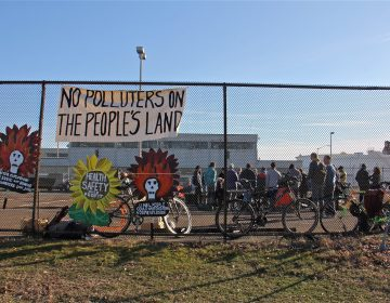 Protesters gather in a parking lot at the Philadelphia Energy Solutions refinery office on Passayunk Avenue in South Philadelphia. (Emma Lee/WHYY)