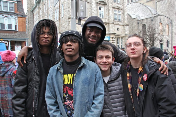 Studemts from the Philly Free School, an alternative school in West Philadelphia, attend a protest against Vice President Mike Pence, who was speaking at St. Francis de Sales School. They are (from left) Prey Lambert, Miles Conyers, Sabri Stamps, Ivo Linkin and Tobias-Maxwell Steich-Otto. (Emma Lee/WHYY)