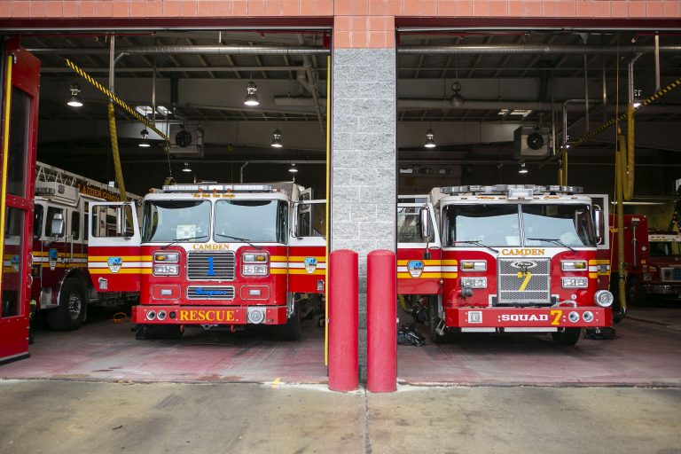 Fire trucks are parked inside Liberty Fire Station on Broadway in Camden, N.J.  (Miguel Martinez for WHYY)