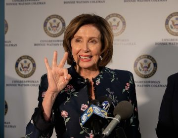 Speaker Nancy Pelosi holds up three fingers in reference to H.R. 3, the Elijah E. Cummings Lower Drug Costs Now Act in Trenton, NJ. (Becca Haydu for WHYY)