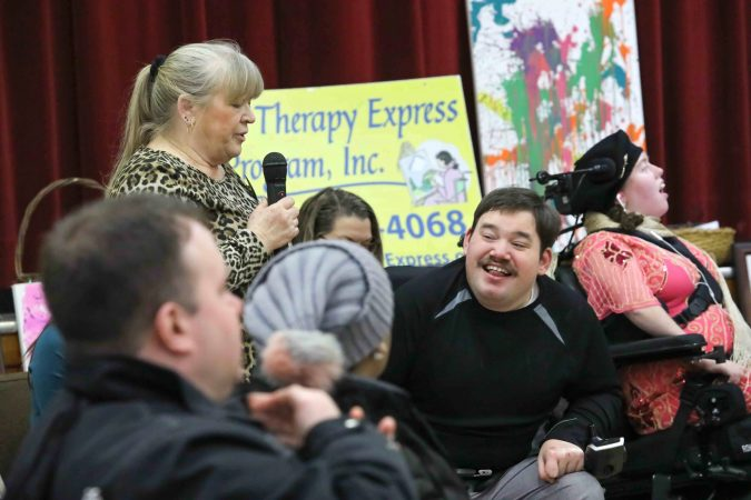 Cindy and Dillon Starkey give remarks during during an art therapy exhibit on Feb. 10, 2020, at The Art Studio in Wilmington, Del. (Saquan Stimpson for WHYY)