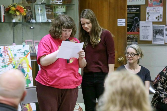 Emily Roark (left) gives remarks during an art therapy exhibit on Feb. 10, 2020, at The Art Studio in Wilmington, Del. (Saquan Stimpson for WHYY)