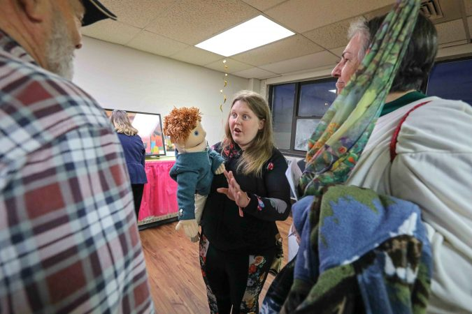 Lora Divorski (center) speaks with attendees about her work during an art therapy exhibit on Feb. 10, 2020, at The Art Studio in Wilmington, Del. (Saquan Stimpson for WHYY)