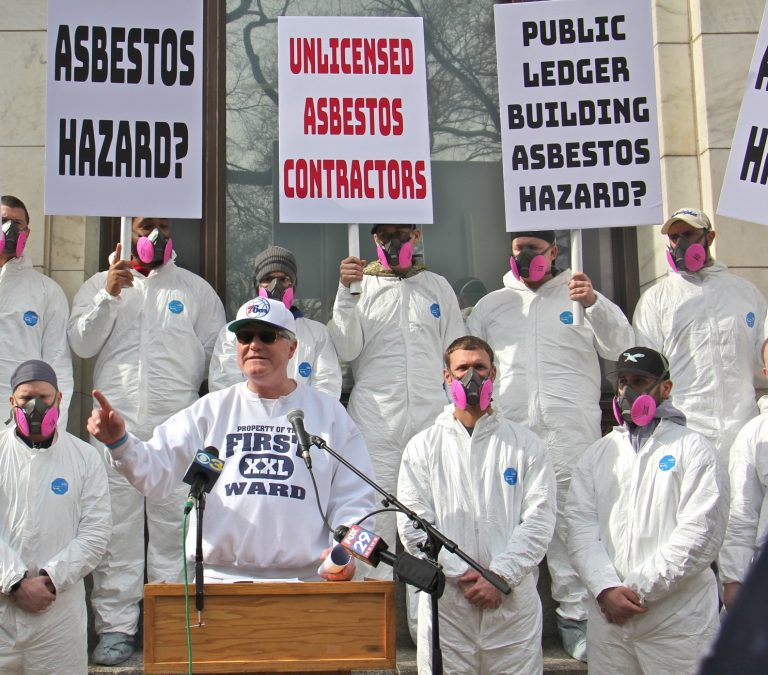 John Dougherty, business manager of the International Brotherhood of Electrical Workers in Philadelphia, criticizes the owner of the Public Ledger Building for unsafe handling of asbestos. (Emma Lee/WHYY)