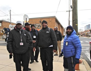 Twenty PAAN members canvassed the neighborhood offering city resources after a quadruple shooting rocked the community Wednesday. (Ximena Conde/WHYY)