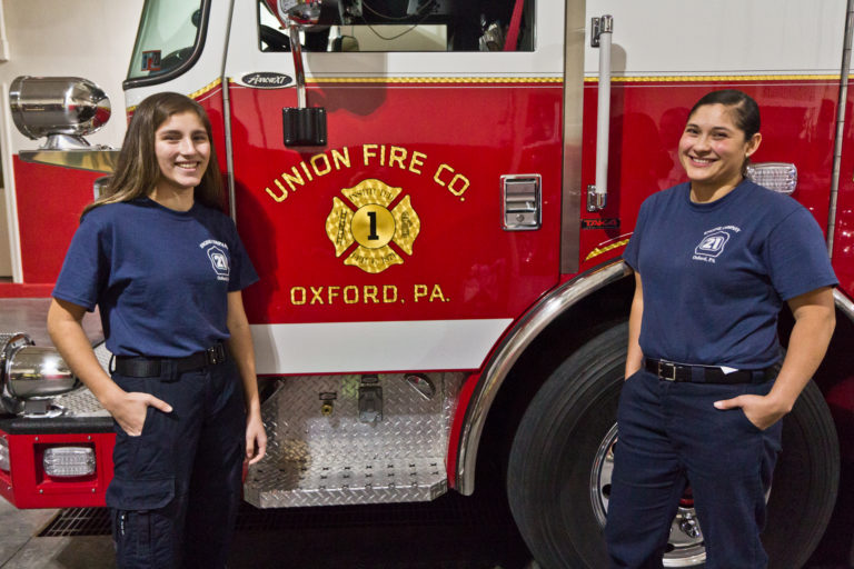 Carolena Nava and her mom Lupita Nava are volunteer firefighters in Oxford, Pa. (Kimberly Paynter/WHYY)