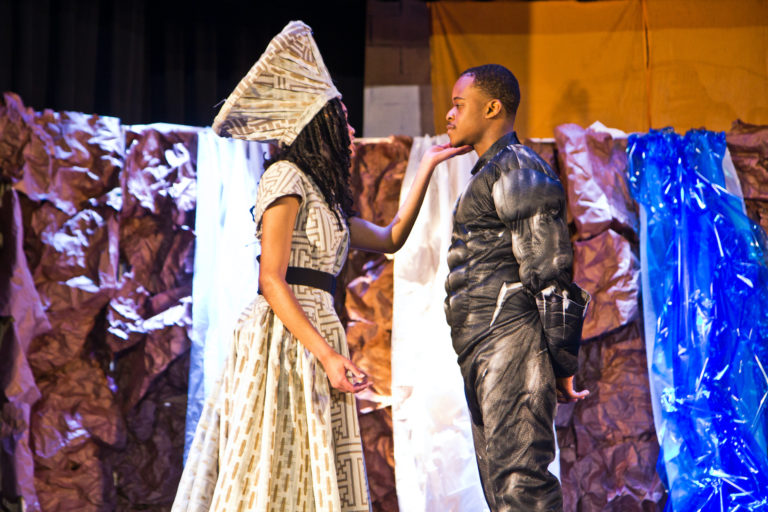 Students performing as Queen Ramonda and her son, T'Challa, on stage during a rehearsal for the 'Black Panther' musical at Willingboro High School. (Kimberly Paynter/WHYY)