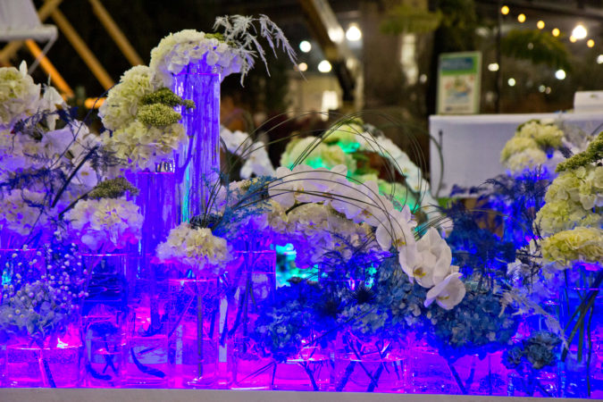 """""""On the Sea"""" a design by Haddonfield's Arrange, Floral and Event Design, being built Thursday at the 2020 Flower Show. (Kimberly Paynter/WHYY)"""