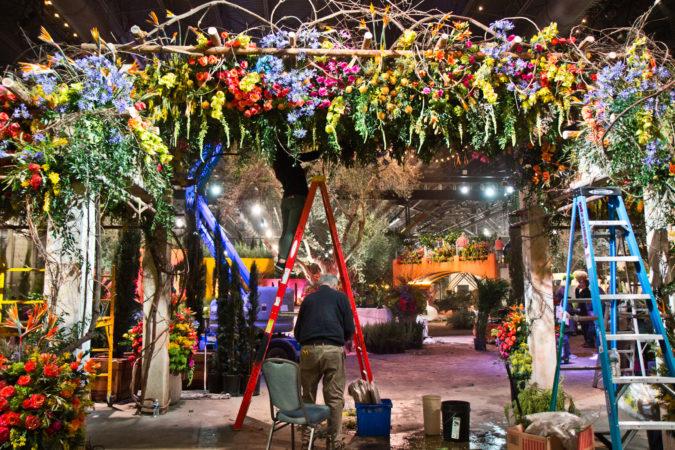 PHS staff work to finish the main exhibit of the Philadelphia Flower Show Thursday. (Kimberly Paynter/WHYY)
