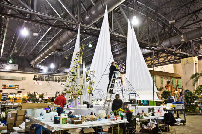 """On the Sea"" a design by Haddonfield's Arrange, Floral and Event Design, being built Thursday at the 2020 Flower Show. (Kimberly Paynter/WHYY)"