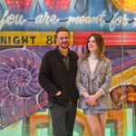 """Dispatches From Elsewhere"" stars Eve Lindley (right) and Jason Segel (left) pose with local street artist Jimmy McMenamin's new mural at the Comcast Center. (Kimberly Paynter/WHYY)"