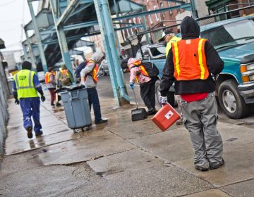 Lottery winners from Philadelphia's Work-to-Earn program clean up the streets of Kensington Ave. (Kimberly Paynter/WHYY)