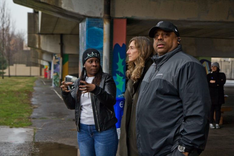 Wysenia Williams, vice president of the advisory council for East Poplar playground (left), with Kira Strong, new executive director of the Rebuild program (center), and Todd Gross, facility manager at the playground. (Kimberly Paynter/WHYY)