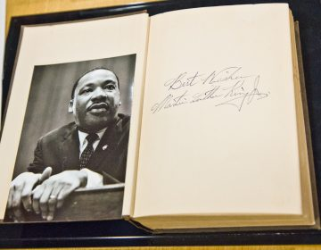 Peter Del Borrello III's shop at Broad and Washington has become home to an unexpected artifact: a Bible inscribed by Martin Luther King Jr. (Kimberly Paynter/WHYY)