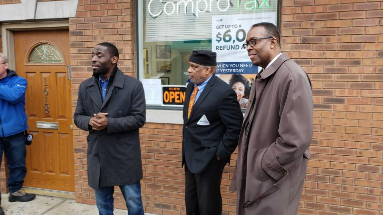 Councilmembers Isaiah Thomas (left) and Darrell Clarke (right) with ComproTax owner Timothy Nelson. (Tom MacDonald/WHYY)