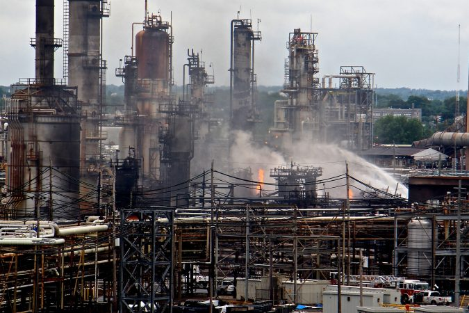 A fire burns at the Philadelphia Energy Solutions refinery hours after a series of early morning explosions on June 21, 2019. (Emma Lee/WHYY)