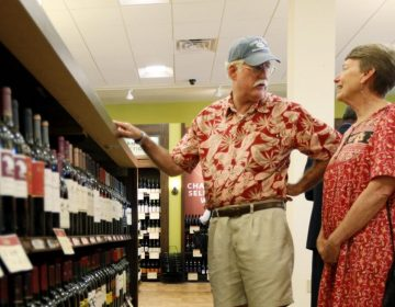 In this Thursday, July 22, 2010 photo, Hugh and Karen Hoffman of Wycombe, Pa. shop a newly opened state wine and liquor store in New Hope, Pa. (Matt Rourke / AP)