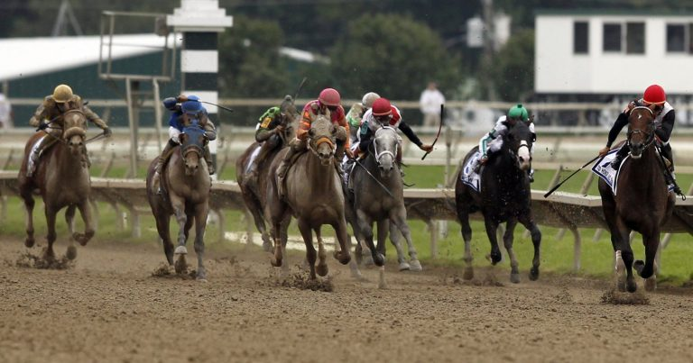 To Honor and Serve, right, with jockey Jose Lezcano aboard, heads to the finish line during the running of the Pennsylvania Derby horse race at Parx Racing, Saturday, Sept. 24, 2011, in Bensalem, Pa. (Alex Brandon / AP Photo)