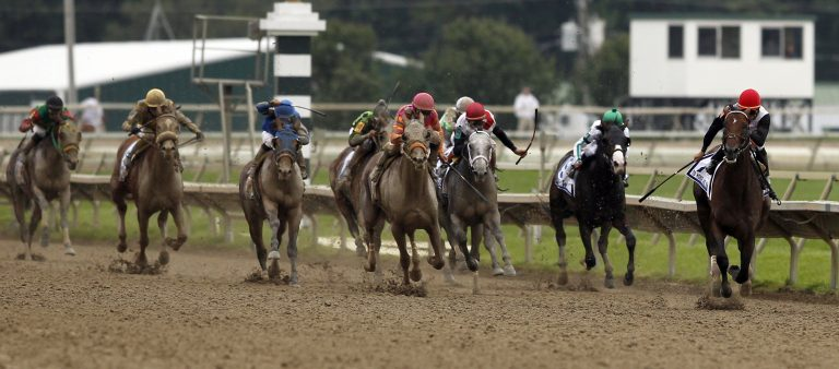 To Honor and Serve, right, with jockey Jose Lezcano aboard, heads to the finish line during the running of the Pennsylvania Derby horse race at Parx Racing, Saturday, Sept. 24, 2011, in Bensalem, Pa. Alex Brandon/AP Photo)