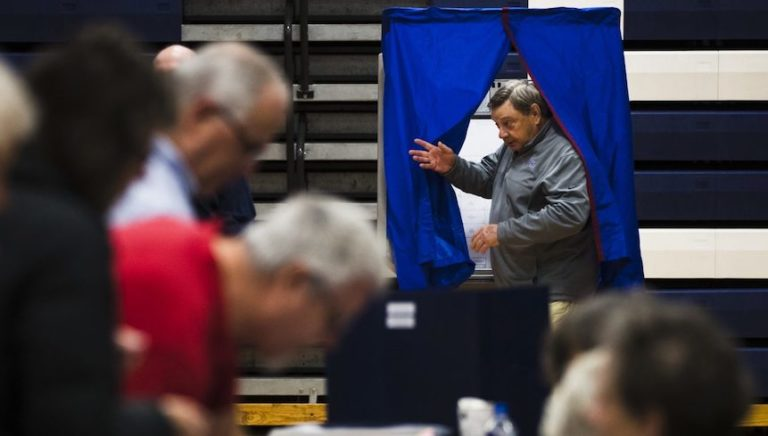 A voter steps from the voting booth after casting his ballot in Doylestown, Pa., Tuesday, Nov. 6, 2018. (Matt Rourke/AP Photo)