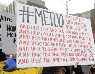 In this Jan. 20, 2018 file photo, a marcher carries a sign with the popular Twitter hashtag #MeToo used by people speaking out against sexual harassment as she takes part in a Women's March in Seattle. (AP Photo/Ted S. Warren, File)