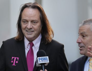 T-Mobile chief executive John Legere speaks to reporters as he leaves the courthouse in New York, Wednesday, Jan. 15, 2020. Legere was in court to hear closing arguments in the case that could permit T-Mobile to merge with Sprint. (AP Photo/Seth Wenig)