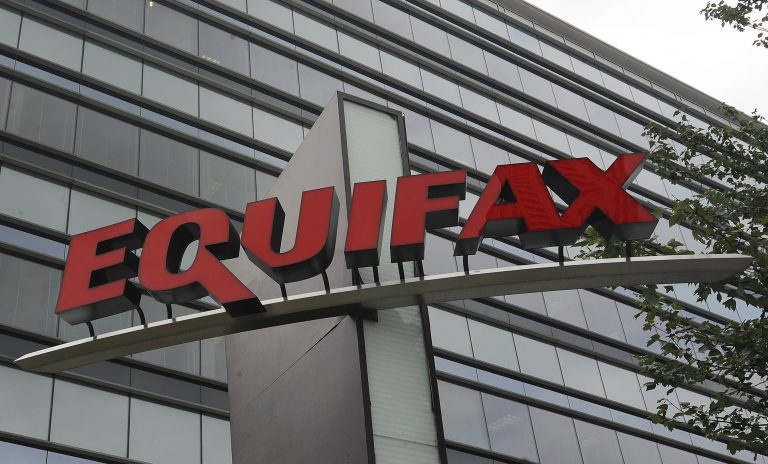 FILE - This July 21, 2012, file photo shows signage at the corporate headquarters of Equifax Inc. in Atlanta. The deadline to seek cash payments and claim free services as part of Equifax's $700 million settlement over a massive data breach is Wednesday, Jan. 22, 2020. (AP Photo/Mike Stewart, File)