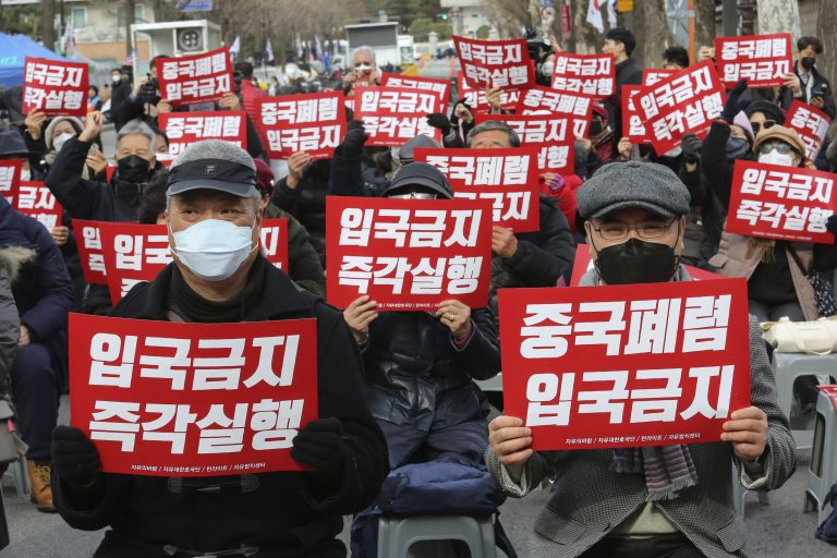 In this Wednesday, Jan. 29, 2020, photo, South Korean protesters stage a rally calling for a ban on Chinese people entering South Korea near the presidential Blue House in Seoul, South Korea. (Ahn Young-joon/AP Photo)