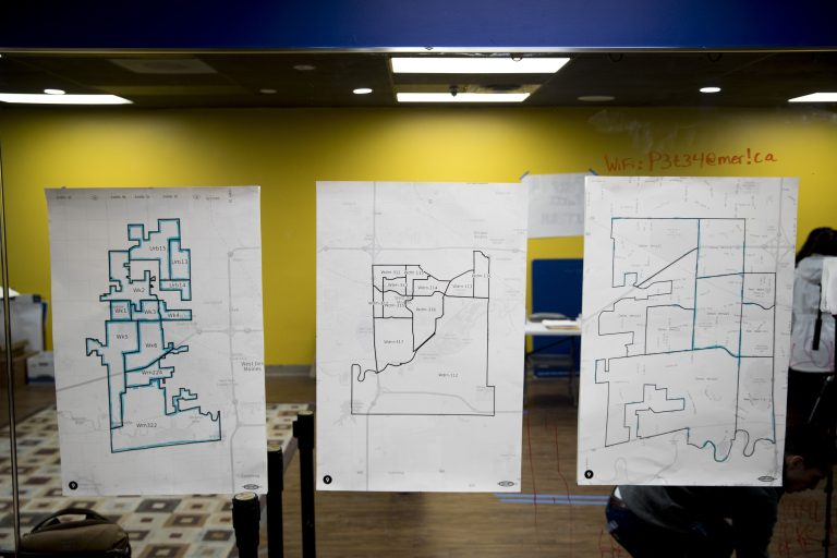 Maps are displayed on the wall of a campaign office for Democratic presidential candidate former South Bend, Ind., Mayor Pete Buttigieg on the day of the Iowa Caucus, Monday, Feb. 3, 2020, in West Des Moines, Iowa. (AP Photo/Andrew Harnik)