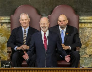 Pennsylvania Gov. Tom Wolf delivers his 2020-21 budget address in the House of Representatives as Speaker Mike Turzai, left, and Lt. Gov. John Fetterman look on, Tuesday, Feb. 4, 2020, in Harrisburg, Pa. (Joe Hermitt/PennLive/The Patriot-News via AP)