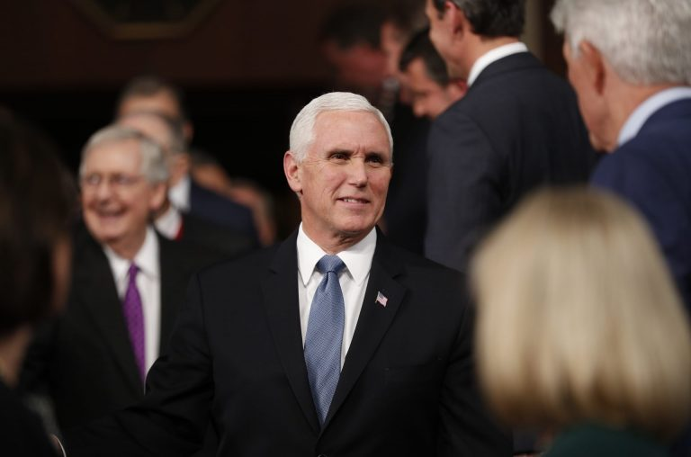 Vice President Mike Pence, center, arrives with Senate Majority Leader Mitch McConnell of Ky., left, before President Donald Trump arrives to deliver his State of the Union address to a joint session of Congress in the House Chamber on Capitol Hill in Washington, Tuesday, Feb. 4, 2020.  (Leah Millis/Pool via AP)