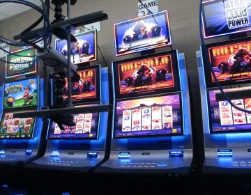 Slot machines in a secure room at the Hard Rock casino in Atlantic City N.J. that have been connected to the internet as part of a new product offering. The technology lets people use the internet to gamble on real-life slot machines that are inside the casino. (Wayne Parry/ AP Photo)