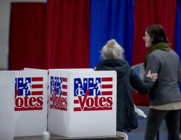 Residents arrive to vote in the New Hampshire Primary at Bishop O'Neill Youth Center, Tuesday, Feb. 11, 2020, in Manchester, N.H. (AP Photo/Andrew Harnik)