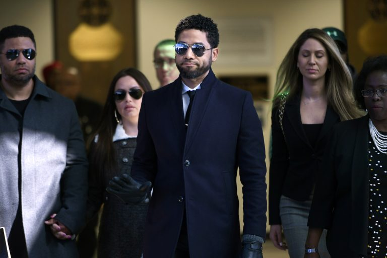 In this March 26, 2019 file photo, actor Jussie Smollett gestures as he leaves Cook County Court after his charges were dropped in Chicago. (Paul Beaty/AP Photo)