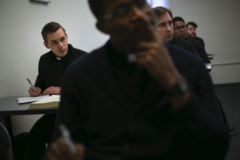 Seminarian Daniel Rice, left, sits with classmates during a lesson on the Gospel of Luke at St. Charles Borromeo Seminary in Wynnewood, Pa. (Wong Maye-E/AP Photo)